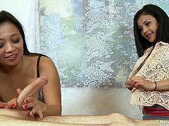 Nasty and perverted MILF teaches younger and unexpirienced brunette how to suck cocks and uses a real dude's dick as an example.