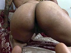 At the start two asstastic ebony bitches fuck missionary style using strapon. Then horny mandingo joins the action getting his thick BBC sucked.