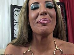 Big boobed MILF Richelle Ryan takes of her swimsuit and plays with her tits. Then she kneels down to blow her man's cock.