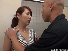 Sexy Japanese milf seduces a guy and gets naughty with him in a small room. She sucks the stud's wang and lets him finger her shaved cunt, then bends over and gets her pink slit drilled.