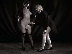 This mistress looks very tempting while wearing sexy lingerie set with pantyhose and garters. She whips her slave's ass hard until it turns scarlet red.