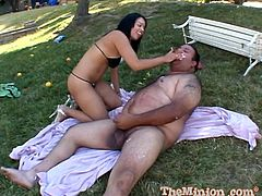 A sweet Latina sucks a tiny dick in a backyard. Then this pretty girl lies down on a ground and gets fucked by a fat guy. In the end he cums on Aliana's beautiful face.