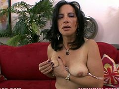 Hot and torrid MILF Melissa Monet takes off her office uniform and stays in lacy underwear. She gets horny and starts fingering her pussy.