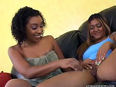 Hot ebony chick and her asian friend are ready to have some fun in their love nest. The ebony starts to finger her chocolate pussy and licks her friend's clit.