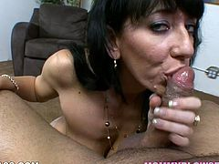 Dark haired mommy with big saggy titties Alia Janine unzips her stud and starts jacking off his massive dick. Milfie titfucks that big boner and shows off her cock sucking skills.