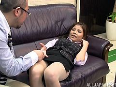 A pretty Japanese girl in office suit talks to her colleague. After some time she lies down on a sofa and lifts a skirt up. The guy plays with Honami's hot pussy.