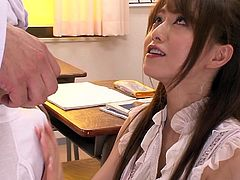 Have you ever fantasized about squeezing you sexy teacher's tits? A seductive teacher wearing makeup offers a dream blowjob. Watch the naughty milf getting down on her knees to lick balls and suck deeply. She takes off her white shirt. Notice her tempting breasts coming out from a kinky red bra.