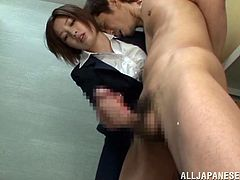 This Japanese hottie seems to be some kinda detective or something cos she's packin' a gun but she loves to suck cock!