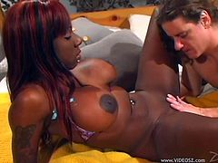 Busty black chick Kelly Starr shows her pierced coochie to a guy and lets him play with it. Then she sits down on the man's boner and they fuck in the reverse cowgirl position.