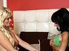 Alexis Ford and Lela Star kiss each other on the lips and on the cleavage. Lela reveals Alexis's boobies and sucks on both her nipples hard, making her wet.