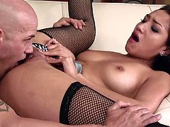Vicki Chase wears fishnet stockings while being fucked