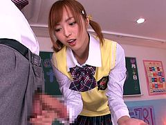 This cute Japanese girl needs to get her hands on every cock she sees. She gets up on the desk and spreads her legs open wide for her classmates to see. This turns on the men so much. Thankfully she tugs them all off.