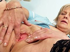 Mature and very horny, Brigita, is eager for a harsh stimulation all over her cramped and dry cunt