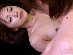 Sexy Japanese chick Saki Kouzai wearing stockings is having fun with a guy in an office. She sucks his weiner ardently and they fuck in the reverse cowgirl position.
