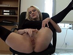 Sexy milf dressed in black outfit feels like playing with her creamy clit while at the office