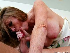 This spoiled whore gets the young stud's cock she craves. She takes his meat stick in her filthy mouth and sucks it passionately like mad. A bit later he fucks her twat from behind.
