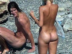 Voyeur feeds his lust by watching in secret how nude girls are enjoying a day at the beach