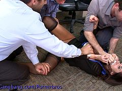 These three guys can't resist the sexyness of their colleague anymore, so they abuse her by fucking all her holes in the office.