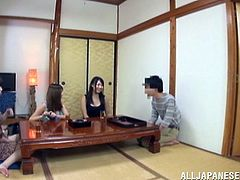 Three naughty Asian girls show off tits to some dude. Then they take off clothes and have fun in a outdoor bath.