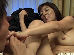 Slim Japanese mom shows her pussy to a guy and lets him eat it. Then they bang in the side-by-side and other positions and the milf moans loudly with pleasure.