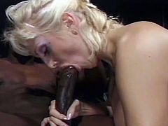 The busty blonde slut is getting her mouth and ass drilled by a giant black penis. She bounces on that dick like crazy and she loves it.