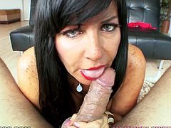Fucktastic cougar with black hair and lusty eyes Tara Holiday shows off her big natural tits before going down on her cocky stud. Chec out how Tara gives blowjob on POV video.