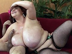 She might be big, but her tits are gigantic. Still, that doesn't stop her from getting on top of this guy and bouncing on his cock.