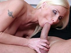 Captivating blonde mom Vanessa Hell wearing a miniskirt and stockings is getting naughty with a guy indoors. She shows her awesome body to the dude and then pleases him with a deepthroat blowjob.