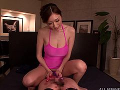 Captivating Japanese chick Julia is getting naughty with a man indoors. She plays with the stud's prick, rubs it against her pussy and her awesome natural tits move from side to side.