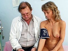 Vladimira's tight butt hole and shaved twat are about to get fully stretched by doc's hands in full gyno exam