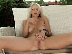 Blonde with massive knockers gets naked and fucks herself with dildo