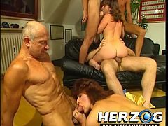there's plenty if fucking and sucking going on in this classic orgy film. One chick is on the couch as rides cock and takes turns sucking the cocks of two different men. Another guy is getting sucked by yet another chick and she's also getting rammed from being by an old guy.