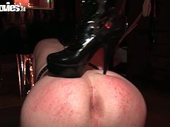 Blond haired mistress Cruella dresed as police officer treats her submissive man, whipping him and inserting anal beads in his butthole.