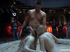 Take a look at this hot scene where these sexy ladies battle in a mud pool as they end up having a threesome with a guy joining the fun.