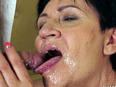 Get a boner watching this brunette granny, with natural breasts wearing sexy lingerie, while she gets nailed hard by a naughty boy.