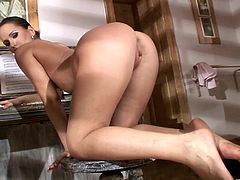 Slutty brunette Aleska Diamond is having fun indoors. She dances in front of a mirror, then strips and finger-fucks her shaved pussy.