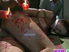 Japanese slave Reiko Sawamura covered in hot wax