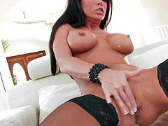 Press play on this solo scene and watch the beautiful brunette Jessica Jaymes taking off her sensual lingerie and fingering her pussy with stockings on.