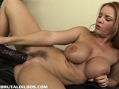 Brunette milf Janet Mason with outstanding juggies was shocked that she was given a massive dildo to pleasure her unshaved pussy. She immediately had multiple orgasms because of it.