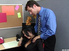 Gorgeous brunette office girl Diamond Kitty is getting naughty with James Deen at her work place. She gives a blowjob and a titjob to James and they have sex in the standing position and doggy style.
