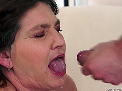 Gorgeous granny ecstatic as her big tits are squeezed then gives a tit job before he masturbates her pussy with a toy then pounds on her doggy style