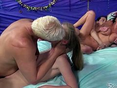 Two slender girlfriends invite horny dudes to spice up their lesbian orgy. They polish their dongs and give each other tongue job.