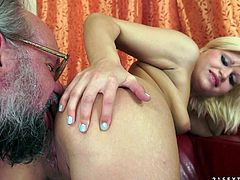What are you waiting for? Watch this blonde babe, with natural boobs wearing shorts, while she gets fucked by a really nasty old man.