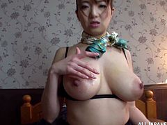 Hot Japanese milf Mio Takahashi strips and shows her awesome big natural tits to a guy. Then she takes his weiner in between her boobs and massages it remarcably well.