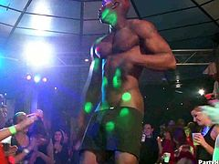 Horny babes is a discos try to pull the clothes off of a hot black stripper Watch as they start to blow his cock before taking it deep into their horny mouths.
