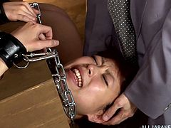 Humiliated Japanese cutie locked in a box like a slave gives a blowjob then moans as her pussy is vibrated before the gang bangs her