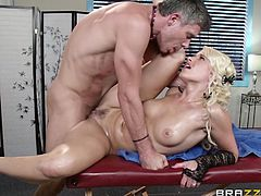Make sure you see this! A blonde pornstar, with a nice ass and big jugs, goes really hardcore covered in oil with a kinky dude. She's a naughty slut!