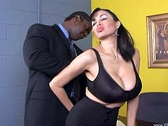 Curvy brunette milf Claudia Kealoha is getting naughty with a black dude indoors. She drives him crazy with a blowjob and then they have doggy style sex on a desk.