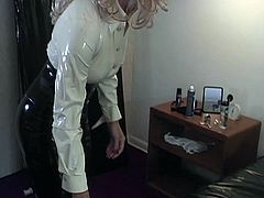 Maid dressed in latex and bound