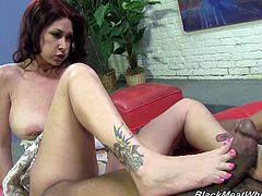Beautiful dark-haired milf Tiffany Mynx is getting naughty with a black guy indoors. She shows her nice feet to the man and lets him kiss her heels and suck her toes.
